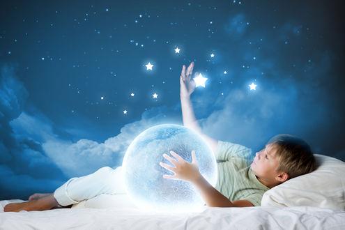 Фото Мальчик лежит среди облаков, обнимает планету и трогает звезды, by Adfave