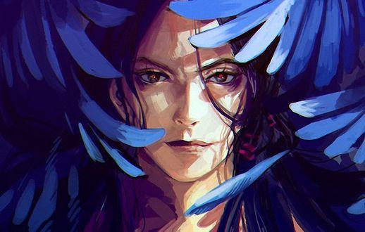 Фото Человеческое лицо среди синих птичьих перьев