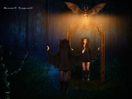 Фото В лесу девушка летучая мышь, смотрит в свое отражение в зеркале