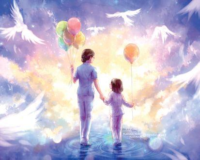 Фото Женщина и девочка с шариками в руках стоят в воде, в окружении белых птиц