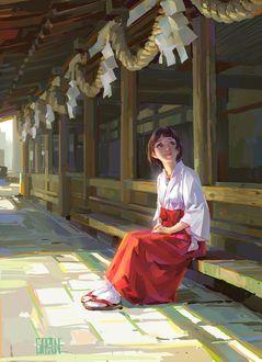 Фото Девушка в традиционной одежде сидит на пороге дома