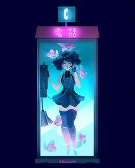 Фото Девушка стоит в телефонной будке и звонит, by vicki