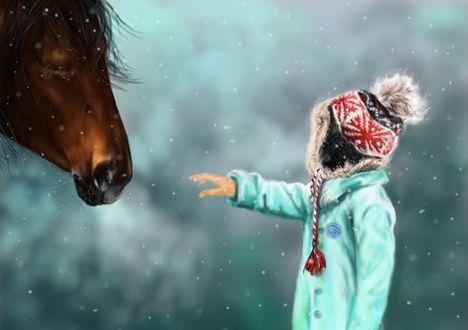 Фото Девочка протянула руку к лошади