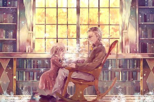 Фото Внучка с дедушкой читают книгу