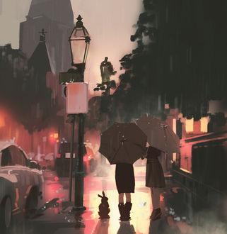 Фото На мокрой вечерней улице стоят под зонтиками две девушки и рядом сидит заяц