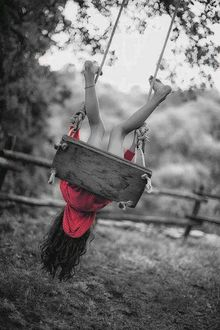 Фото Девочка катается на качелях вверх тормашками, by korshun