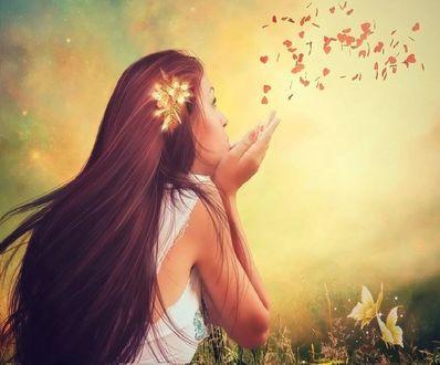 Фото Девушка с красивой заколкой в волосах, сдувает с ладошек семена цветов в виде сердечек, by MaureenOlder