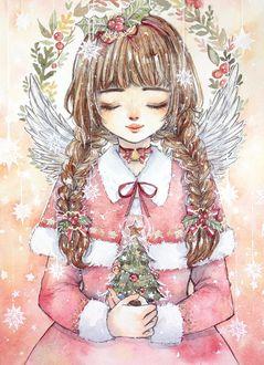 Фото Девушка - снегурочка, с крылышками за спиной, с елочкой в руках