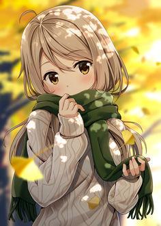 Фото Девочка в свитере и шарфе