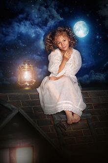 Фото Девочка сидит на крыше дома, рядом горит фонарь, светит луна, на ночном небе звезды