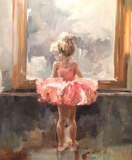 Фото Будущая балерина, девочка в розовой пачке и пуантах стоит за станком перед зеркалом