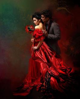 Фото Влюбленный молодой человек обнимает девушку в красном платье с открытой спиной, которая в руке держит веер на длинной палочке