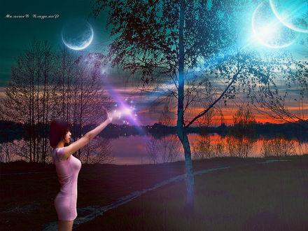 Фото Девушка в розовом платье соединяет лучи планет на закате