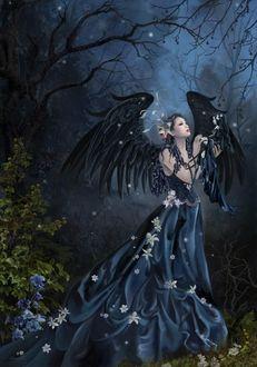 Фото Девушка чернокрылый ангел в длинном платье, украшенном цветами, стоит в мистическом лесу, держа в руке куклу, by Nene Thomas
