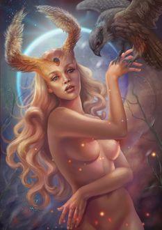 Фото Обнаженная девушка с рогами в виде крыльев, с украшением на голове, на фоне луны держит на руке птицу, by Vasylina Holodilina