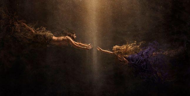 Фото Парень и девушка протянули руки друг к другу в лучах света среди тьмы, фотограф Robert Cornelius / Роберт Корнелиус