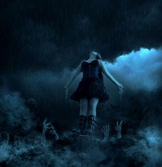 Фото Девушка стоит на вершине горы под дождем, подняв голову вверх, снизу к ней тянутся руки, by Browse Art