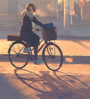 Фото Девушка едит на велосипеде