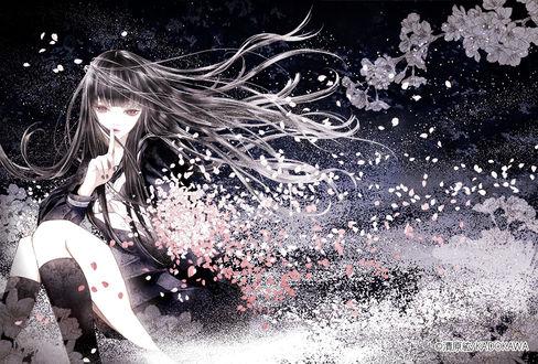 Фото Девушка в окружении падающих лепестков