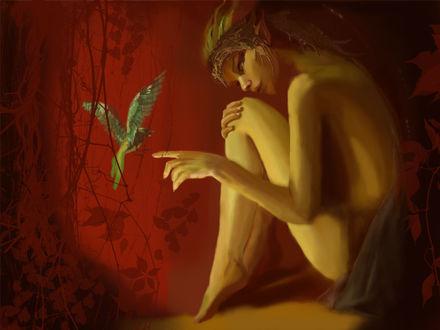 Фото Обнаженная девушка сидит и держит руку перед птицей