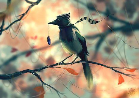 Фото Птица в шапочке и шарфе сидит на ветке с кулоном в клюве