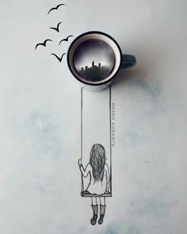 Фото Девочка на качели, подвешенной к чашке, над которой летают птицы