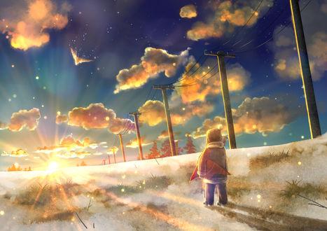 Фото Ребенок стоит на дороге на фоне облачного неба