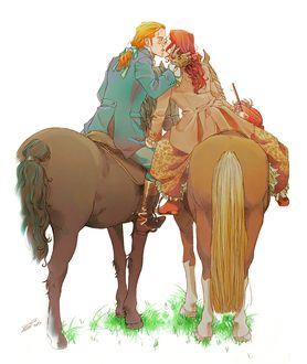 Фото Парень и девушка верхом на лошадях целуются