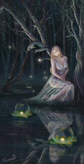 Фото Девушка сидит у водоема с горящими свечами на нем