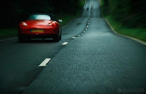 Фото Красное авто на дороге, на размытом фоне, by Adrian Petrisor