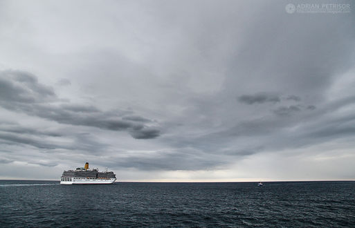 Фото Корабль на воде, вдали небольшой катер на фоне облачного неба, by Adrian Petrisor