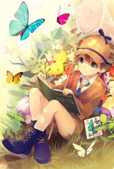 Фото Мальчик с книгой в окружении бабочек