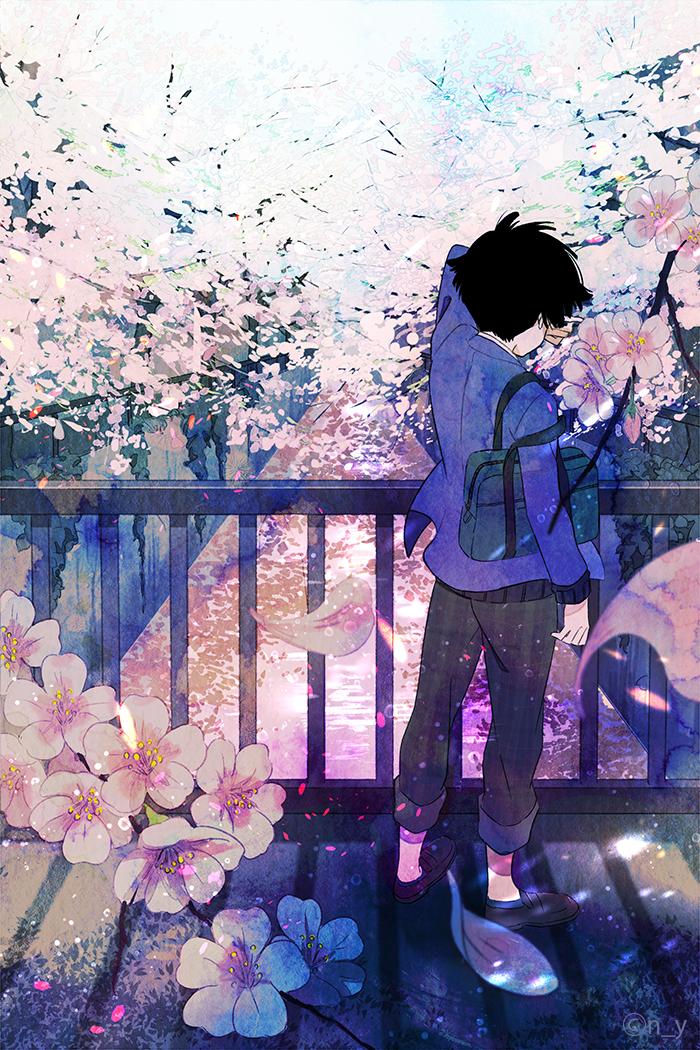 Фото Мальчик с сумкой стоит на фоне цветущих деревьев