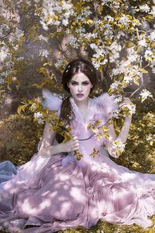 Фото Девушка в нежно-розовом платье сидит под цветущим деревом, by Dark Venus Persephonae