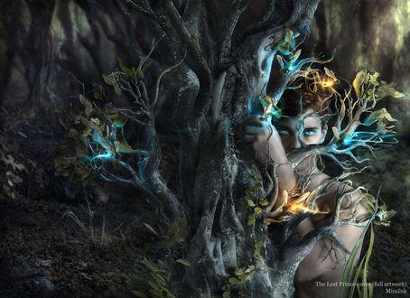 Фото Парень со светящимися глазами стоит за деревом, держась за его ветви, by Marcela Bolivar