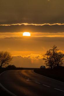 Фото Закат солнца над дорогой, фотограф Timothy Allen