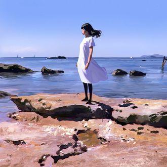 Фото Девушка в белом платье стоит на камнях на фоне моря, by Kuvshinov Ilya