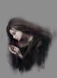 Фото Девушка - вампир держит руки с длинным маникюром перед лицом