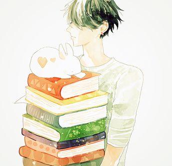 Фото Парень несет стопку книг, на верху которой лежит белый кролик, by tofuvi