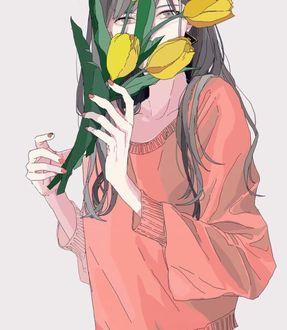 Фото Девушка с желтыми тюльпанами в руке