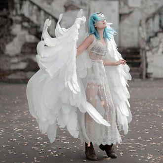 Фото Девушка в образе ангела