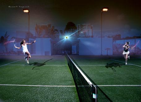 Фото Две девушки играют в теннис под лучами прожекторов