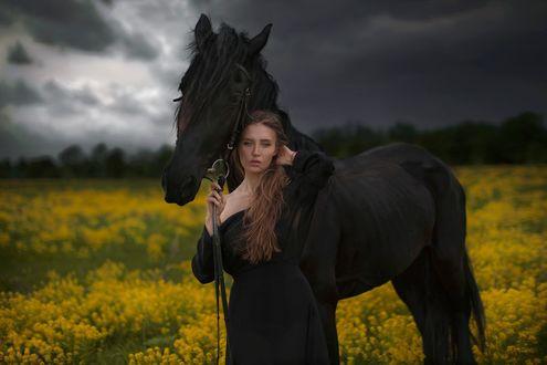 Фото Девушка с лошадью стоит в поле под мрачным небом, by Katerina Plotnikova
