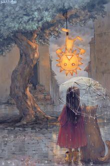 Фото Девочка с кошкой под зонтом смотрят на подвешенное на дереве солнышко