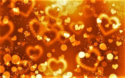 Фото Множество золотых сердечек и искр
