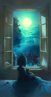 Фото Девочка с котенком сидит у окна и смотрит на полную луну в небе