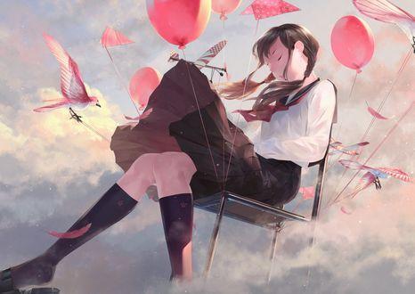Фото Девушка на стуле с шариками парит в облаках