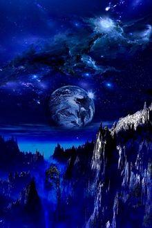 Фото Планета в ночном небе над ущельем