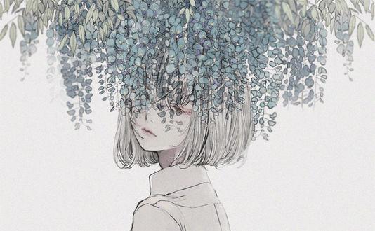 Фото Девушка стоит под цветущей глицинией