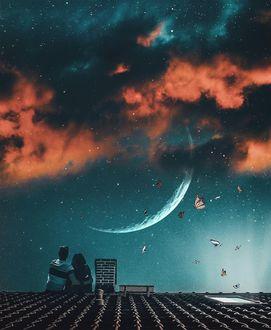 Фото Пара сидит на крыше и смотрит в небо